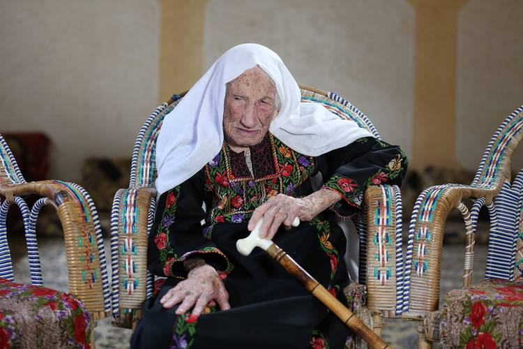 105-year-old Hakma Atallah, a Nakba survivor and Palestine refugee living in Beach Camp, west of Gaza city. Hakma fled from her original village Al-Swafeer in 1948 when she was 35 years old. © 2018 UNRWA Photo by Mohammed Hinnawi.