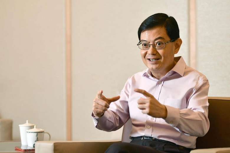 Finance Minister Heng Swee Keat in his first interview since returning to work after suffering a stroke in May. (Via Straits Times / Lim Yaohui)