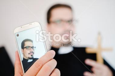 stock-photo-47954200-isolated-priest-selfie