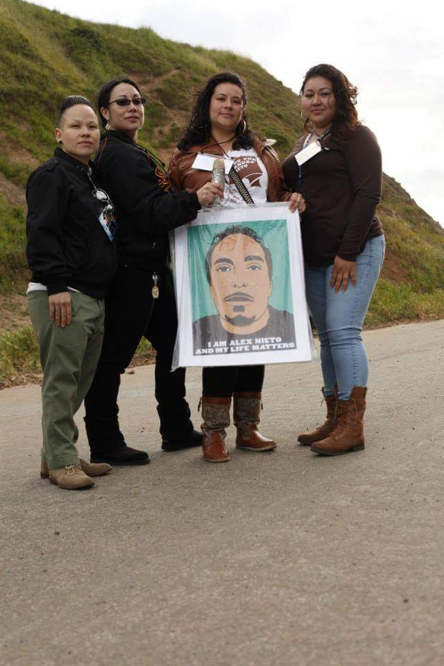 """Photo Credit: Nina Parks, 2014. Homegirls, friends of Alex, holding silkscreened posters """"I am Alex Nieto and my life matters"""" by Jesus Barraza of Dignidad Rebelde collective."""
