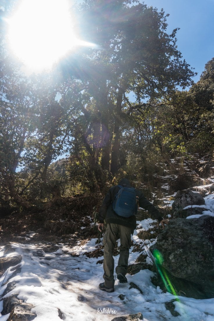Man hiking through snow in Sarmoli
