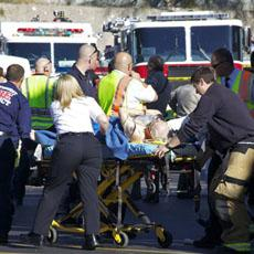Emergency workers treat a shooting victim near the shopping center where the attack took place