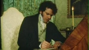 Mr Darcy (Colin Firth) mentre scrive