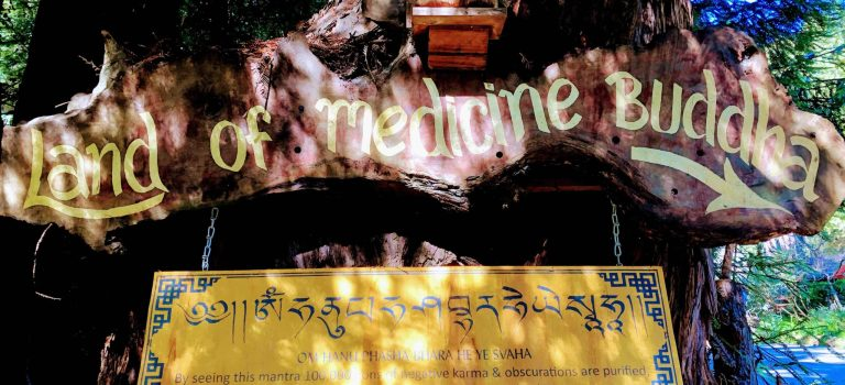 Entrance sign for the Land of Medicine Buddha.