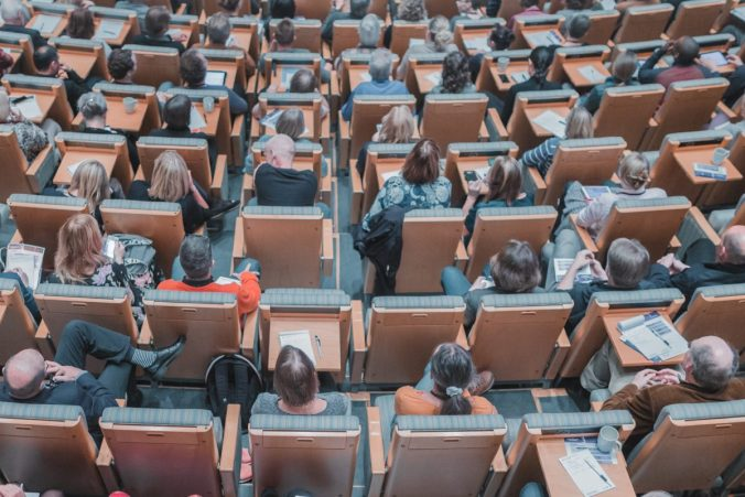 Image of a room full of people attending a lecture. Image credit Mikael Kristenson