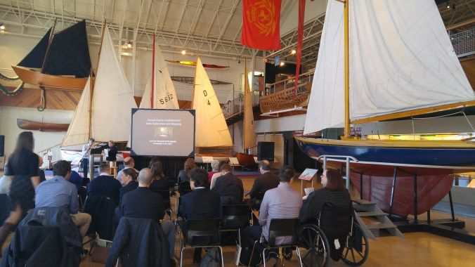 Image of conference attendees surrounded by ships at the Maritime Museum of the Atlantic taken by Author.