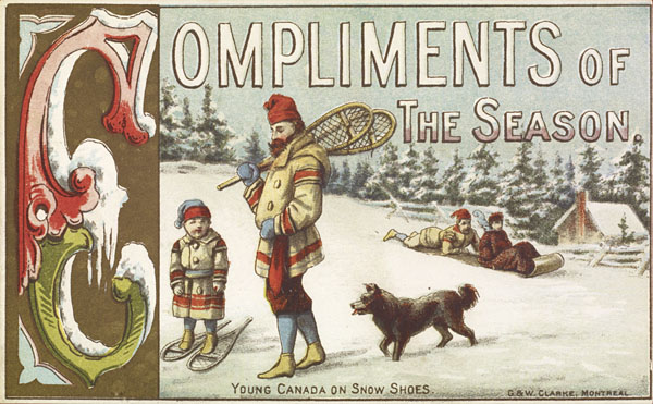 """This Christmas card shows a father and son from the 1870s, standing outside on a snowy hill. They are wearing wool coats in cream with red accent stripes, and tuques. The son is wearing snow shoes and is standing to the left. Next is his father, carrying the snow shoes. They are followed by a brown dog. In the background, two boys are going downhill on a toboggan. And further in the background there are pine trees topped with snow, and a log cabin with snow on the roof. The card's sentiment is: """"Compliments of the Season,"""" and in smaller lettering at the bottom, it says """"Young Canada on snow shoes."""""""