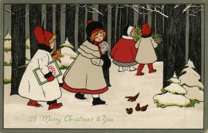 This image features four little girls walking through a winter forest landscape. There are some bare trees and some pine trees with snow on them. Going from left to right, the first little girl has a white coat, a red hat, and red boots. She is carrying a book and a toy horse on a stick. The second little girl is wearing a being coast over a red dress that peeks out from the bottom. She is wearing brown boots, and a black hat with red ribbons. She is carrying a baby doll. The other two girls are slightly ahead of them. The third girl is wearing a red coat with white trim, a patterned grey dress peeking out from underneath. She has white boots, and a black cap with white trim. She and the final girl are carrying holiday greenery. The final girl is wearing a beige coat with red boots, and a red hat. In the foreground, there are also four birds.