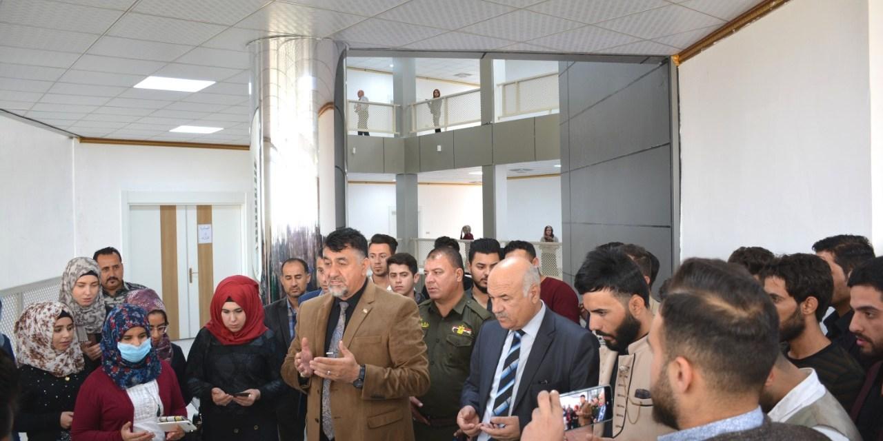 جامعة الحمدانية تنظم وقفة حداد على ارواح الشهداء من المتظاهرين والقوات الامنية