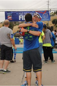 After the Laguna Hills Half Marathon, Greg gives Jeff, from OC Rescue Mission a big hug.