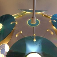 CDs transformed into CDegg Pendant by Gilbert de Rooij