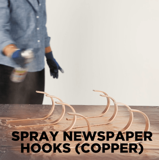 DIY wine rack - newspaper hooks