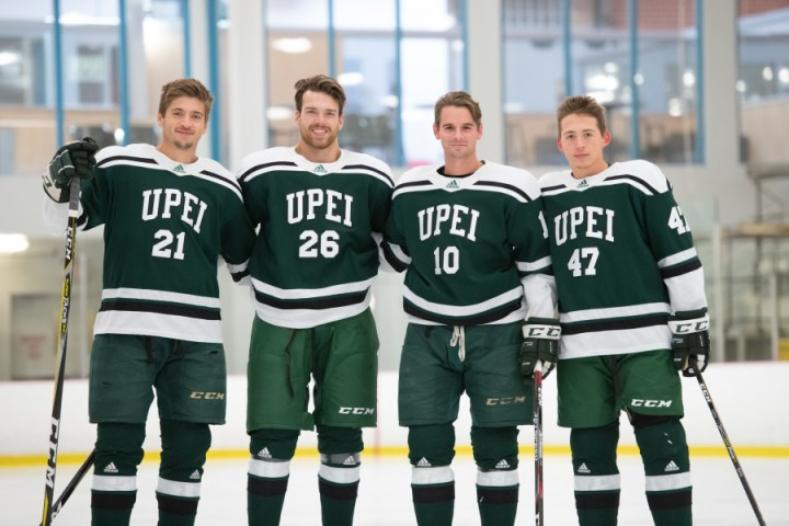 Four male hockey players