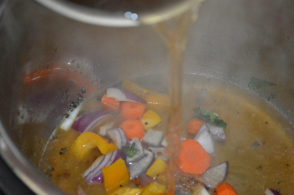 add tamarind water to sambar