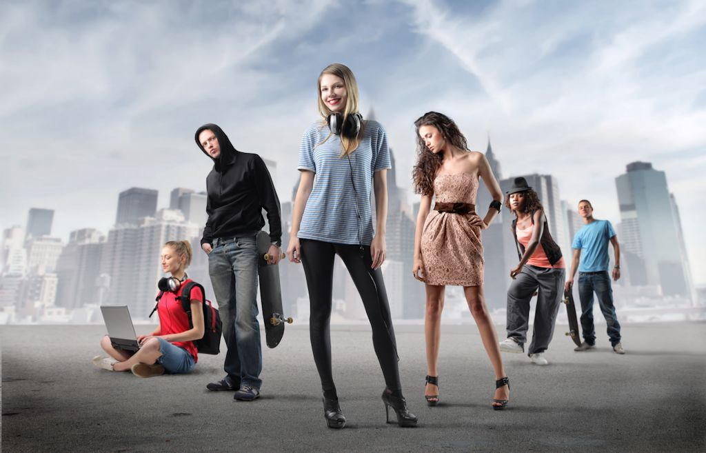 Group of young people in fashion clothes with cityscape in the background
