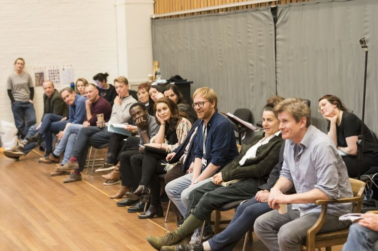 9. The company with director Joe Hill-Gibbins (centre) in rehearsal for Absolute Hell (c) Johan Persson
