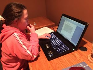Leah working independently on Upside Down's latest blog post!