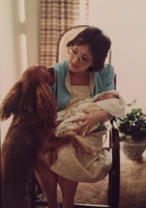 Here is Mom with her first born baby named Leah and with our first dog named Patches. She is introducing us to each other.