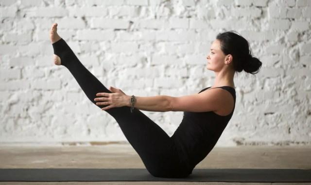 Steps and Benefits of the Navasana Yoga Pose   Uptown Yoga
