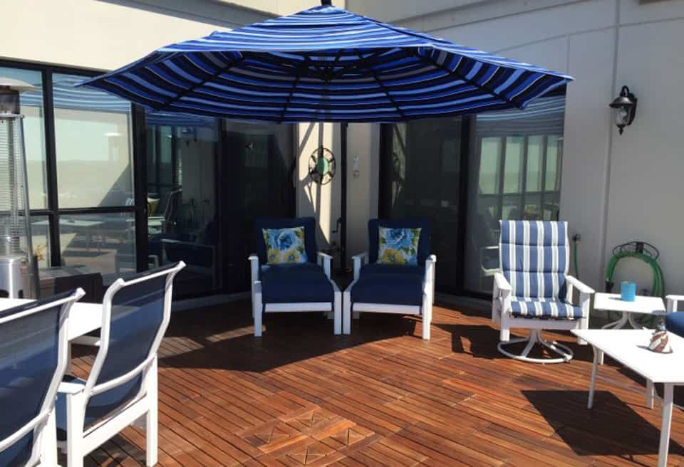 Ipe 1 by 2 foot staggered deck tiles installed on Roof top terrace Canada