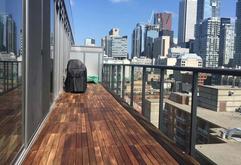 1 by 2 foot Ipe deck tiles installed on balcony with views of Toronto Skyline