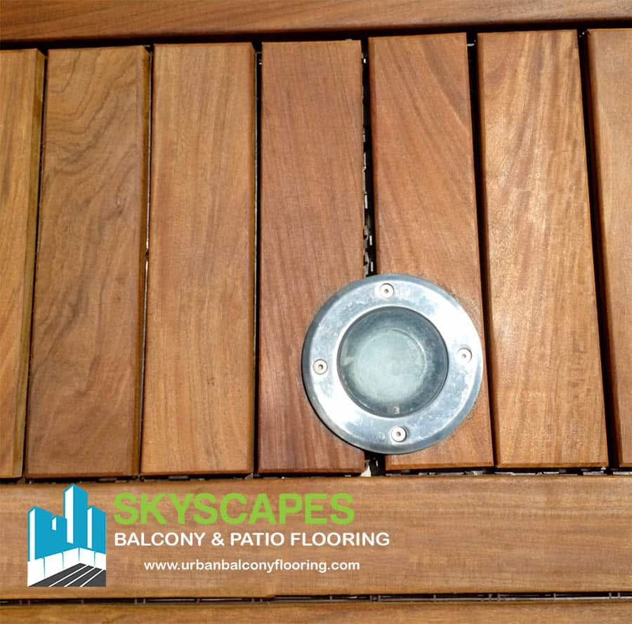 Beautiful Ipe interlocking balcony flooring tiles in Toronto. Lighting built into the tile. Non-stained, natural wood deck tiles.