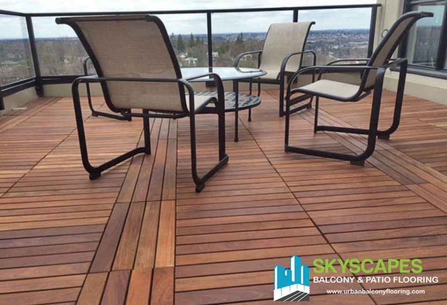 Ipe-lined outdoor floor in Toronto. Custom installation with 2 by 1-foot real wood tiles.