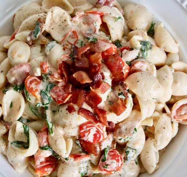 Yummy, rich, creamy BLT Pasta Salad combines two fave comfort foods in one! Recipe on UrbanBlissLife.com.