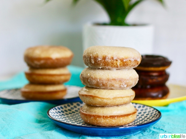Baked Cinnamon Sugar Donuts with Three Glazes stacked. Recipe on UrbanBlissLife.com