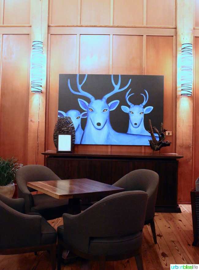 Skamania Lodge Washington lobby painting. Travel stories & hotel reviews on UrbanBlissLife.com