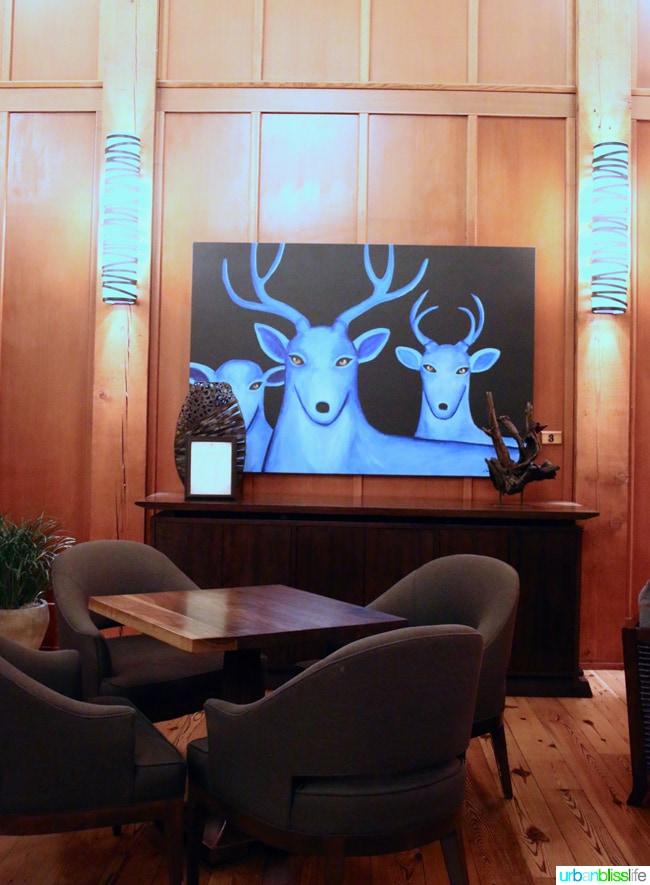 Skamania Lodge Washington lobby painting. Travel stories & hotel reviews on UrbanBlissLife.com
