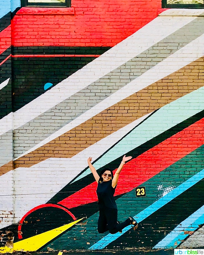 Marlynn Schotland jump shot in Denver, Colorado colorful mural