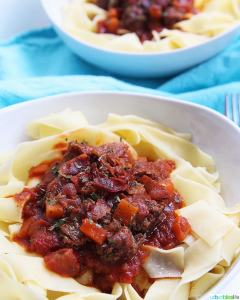 big bowls of Instant Pot Short Rib Ragu over pasta
