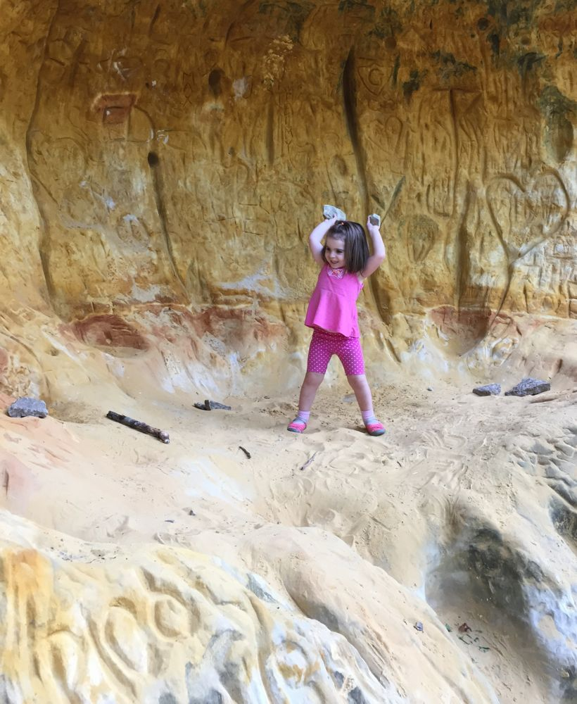 "modern Sugar Cave. A child stands in the colorful sand ""cave"""