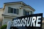 Un panneau indiquant une saisie devant une maison de Stockton en Californie, en avril 2008.