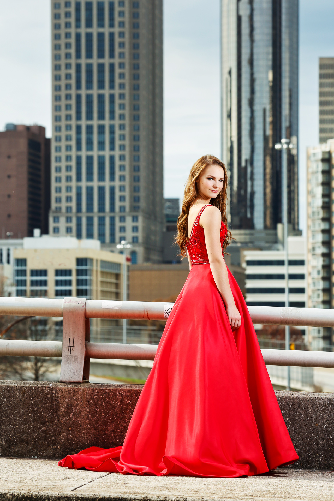 Editorial Senior Photoshoot with a natural beauty in a red dress. Photographed overlooking the skyline of Atlanta.
