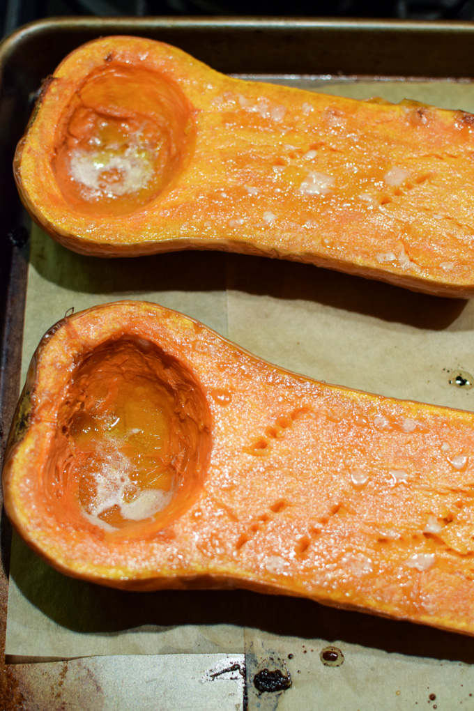 Roasted butternut squash haves on a baking sheet