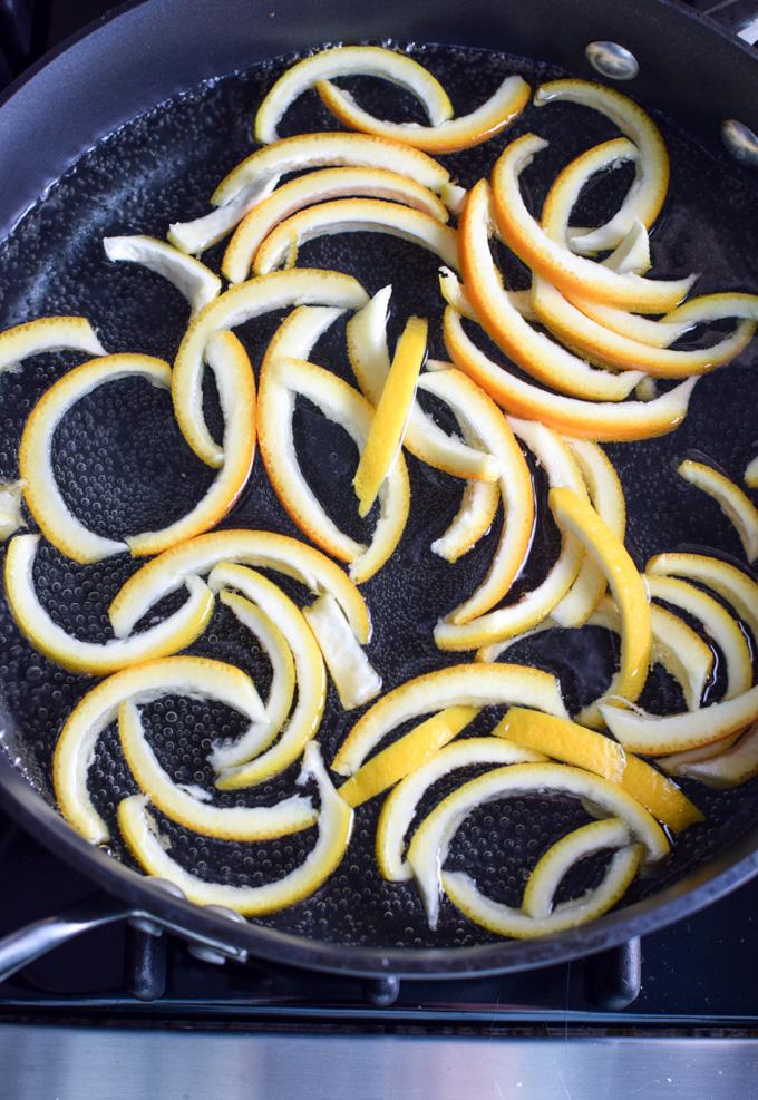 Candied orange peels cooking