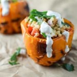 Grilled pepper stuffed with pearl couscous and drizzled with yogurt sauce