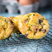Close up of mini turkey sausage egg muffins on a cooling rack