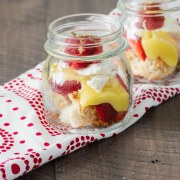 Desconstructed strawberry shortcake with lemon curd in a small mason jar