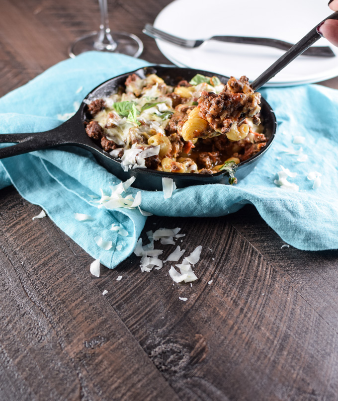 Deconstructed Lasagne in a cast iron skillet with a scoop being served