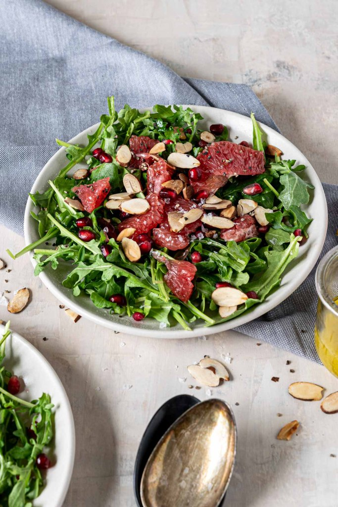 Grapefruit and pomegranate salad on a bed of arugula