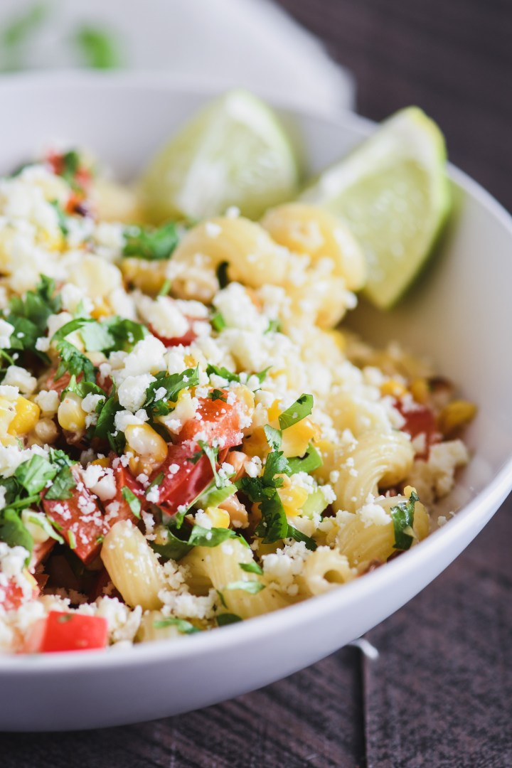 This Mexican Street Corn Pasta Salad is loaded with grilled corn and topped with a tangy lime dressing!