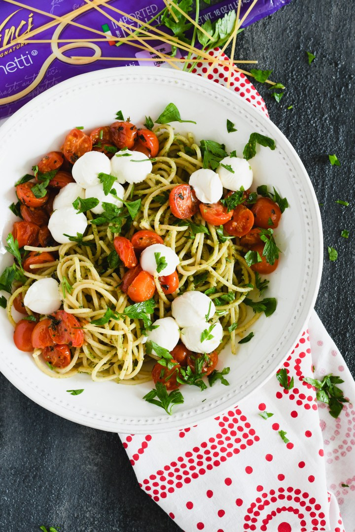 This summer spaghetti is topped with roasted tomatoes for a fresh end of season pasta dish.