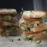 Vegetarian avocado & White bean sandwiches topped with roma tomato