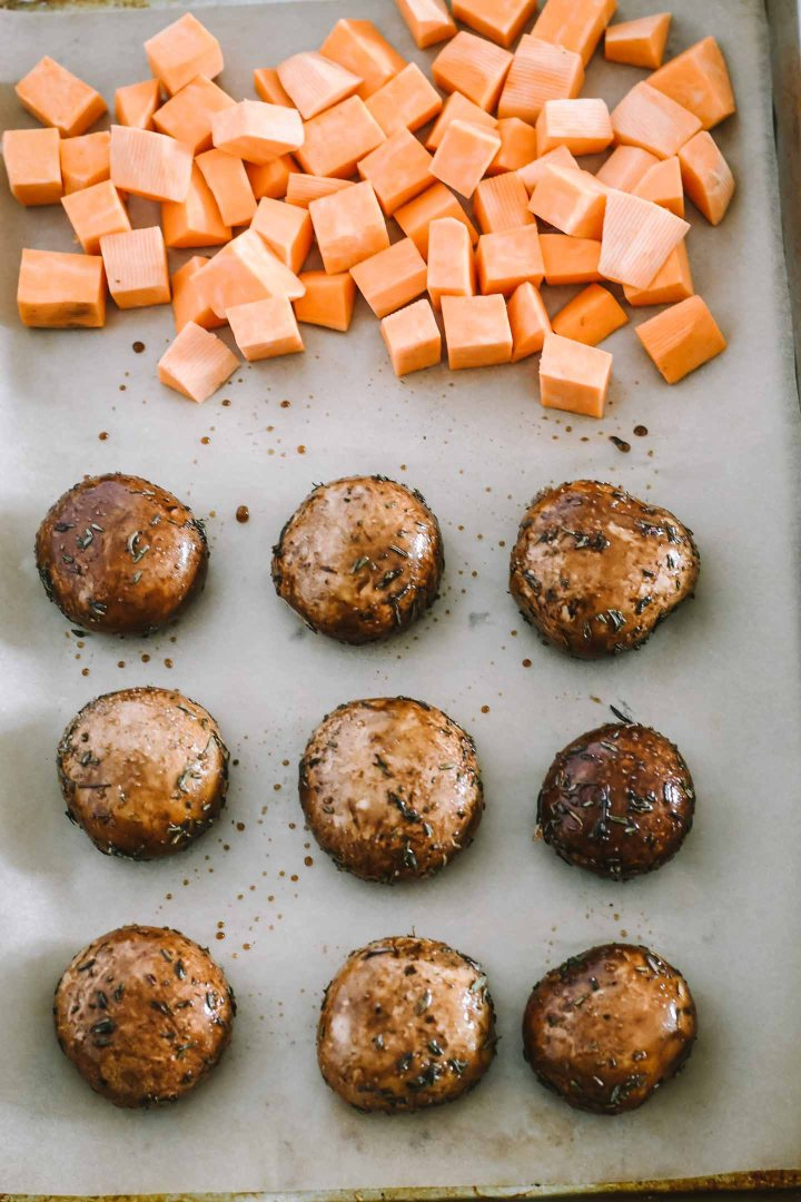 Sweet potatoes and mushrooms on baking sheet