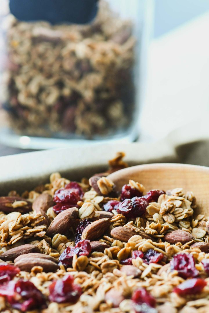 Granola with dried cranberries on a baking sheet