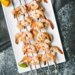 Grilled shrimp on metal skewers