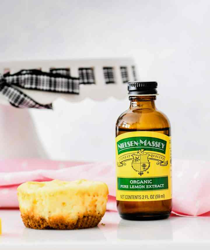 Mini cheesecake with a bottle of Nielsen Massey lemon extract